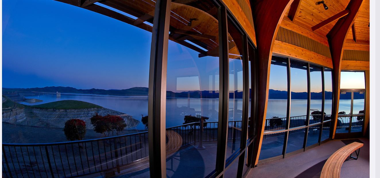 A panoramic view of the San Luis Reservoir from inside the Romero Overlook Visitors Center.