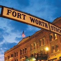 Forth Worth Stockyards sign with historic brick building
